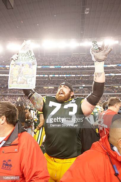 Super Bowl XLV Green Bay Packers Darren Colledge victorious holding Milwaukee Journal Sentinel after winning game vs Pittsburgh Steelers at Cowboys...