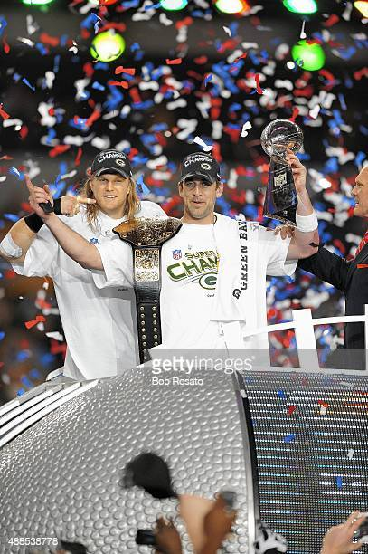 Super Bowl XLV Green Bay Packers QB Aaron Rodgers and Clay Matthews victorious with Vince Lombardi Trophy after winning game vs Pittsburgh Steelers...