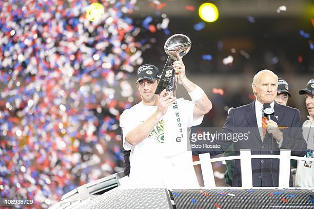 Super Bowl XLV Green Bay Packers QB Aaron Rodgers victorious with Vince Lombardi trophy after winning game vs Pittsburgh Steelers at Cowboys...