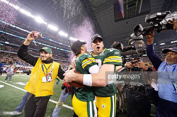 Super Bowl XLV Green Bay Packers QB Aaron Rodgers with Mason Crosby victorious after winning game vs Pittsburgh Steelers at Cowboys StadiumArlington...