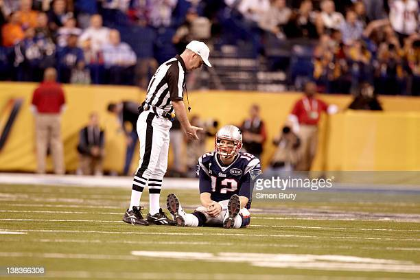 Super Bowl XLVI Referee John Parry offers hand to New England Patriots QB Tom Brady during game vs New York Giants at Lucas Oil Stadium Indianapolis...