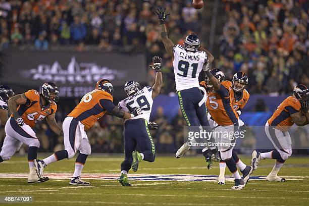 Super Bowl XLVIII Seattle Seahawks Clinton McDonald and Chris Clemons in action defense vs Denver Broncos QB Peyton Manning at MetLife Stadium East...