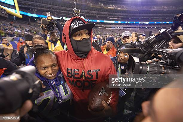 Super Bowl XLVIII Seattle Seahawks Marshawn Lynch victorious with his mother Delisa Lynch after winning game vs Denver Broncos at MetLife Stadium...