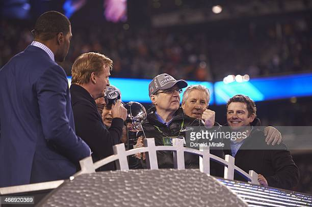 Super Bowl XLVIII Seattle Seahawks owner Paul Allen victorious with Vince Lombardi Trophy after winning game vs Denver Broncos at MetLife Stadium...