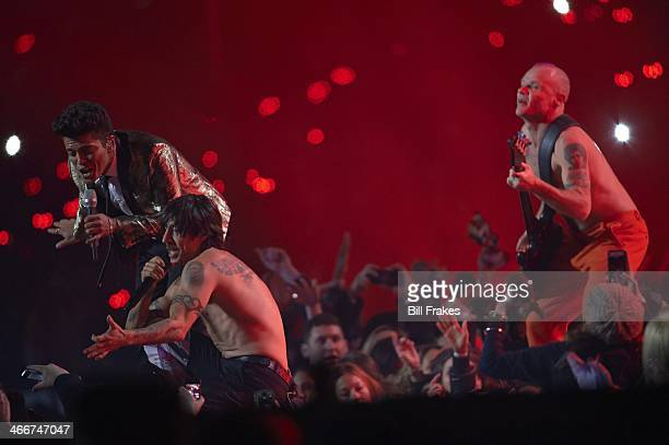 Super Bowl XLVIII View of Bruno Mars performing with Red Hot Chilli Peppers members Anthony Kiedis and Flea during halftime show during Seattle...