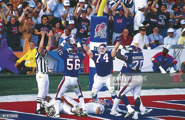 Football Super Bowl XXI New York Giants George Martin Lawrence Taylor Erik Howard and Leonard Marshall victorious after making sack for safety vs...