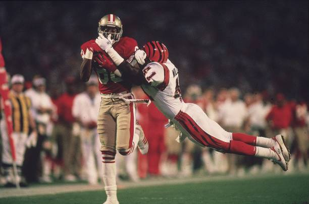 https://media.gettyimages.com/photos/football-super-bowl-xxiii-san-francisco-49ers-jerry-rice-in-action-picture-id81371148?k=6&m=81371148&s=612x612&w=0&h=VqRO_v23alc3kFfg59T6FAIRP64Auhz-rAlrEbHF8Zw=