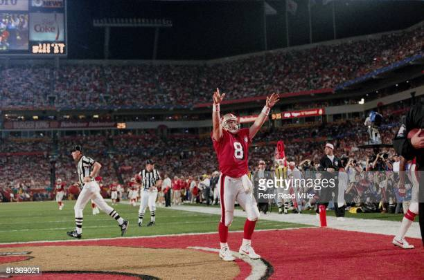 Football Super Bowl XXIX San Francisco 49ers QB Steve Young victorious after TD vs San Diego Chargers View of Joe Robbie Stadium Miami FL 1/29/1995