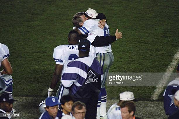 Super Bowl XXVII Dallas Cowboys Michael Irvin victorious hugging head coach Jimmy Johnson after winning game vs Buffalo Bills at Rose Bowl Stadium...