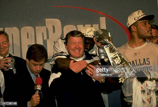 Super Bowl XXVII Dallas Cowboys owner Jerry Jones NBC Sports announcer Bob Costas head coach Jimmy Johnson Michael Irvin and Ken Norton Jr victorious...