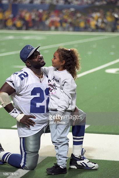 Super Bowl XXVIII Dallas Cowboys Emmitt Smith victorious on sidelines with niece Kendra after winning game vs Buffalo Bills at Georgia DomeAtlanta GA...