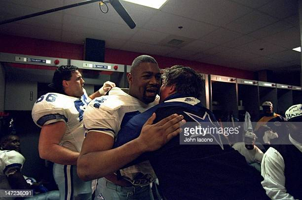 Super Bowl XXVIII Dallas Cowboys head coach Jimmy Johnson and Charles Haley victorious in locker room after winning game vs Buffalo Bills at Georgia...