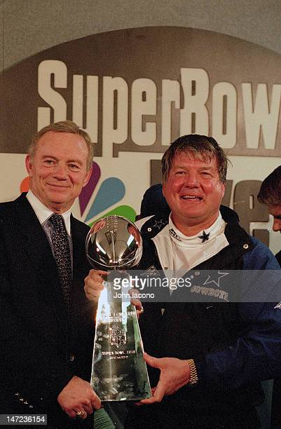 Super Bowl XXVIII Dallas Cowboys owner Jerry Jones and head coach Jimmy Johnson victorious with Vince Lombardi Trophy in locker room after winning...