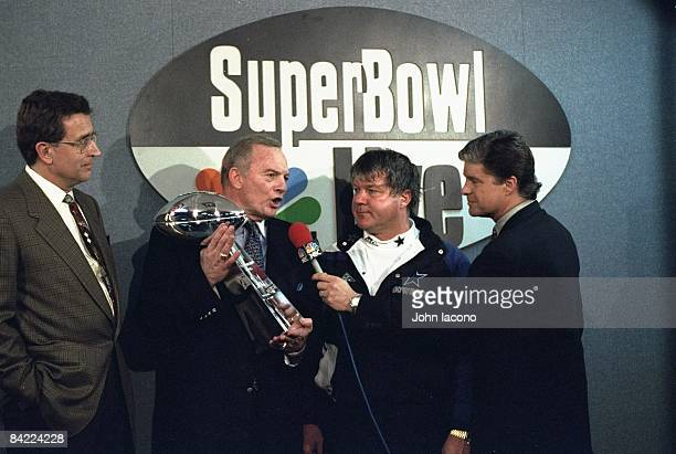 Super Bowl XXVIII NFL Commissioner Paul Tagliabue Dallas Cowboys owner Jerry Jones head coach Jimmy Johnson and Jim Lampley in locker room with Vince...
