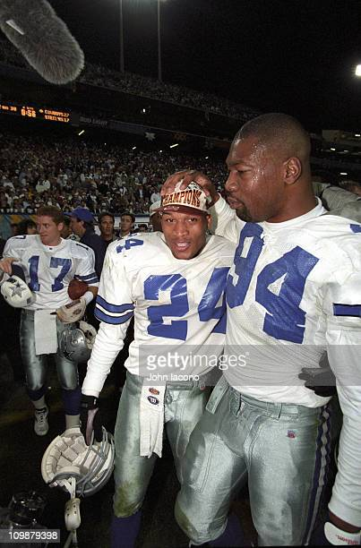 Super Bowl XXX Dallas Cowboys Charles Haley and Larry Brown victorious after winning game vs Pittsburgh Steelers at Sun Devil Stadium Tempe AZ...