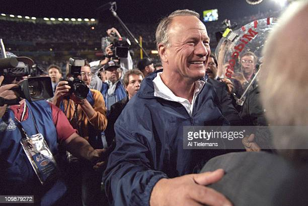 Super Bowl XXX Dallas Cowboys coach Barry Switzer victorious surrounded by media on field after winning game vs Pittsburgh Steelers at Sun Devil...