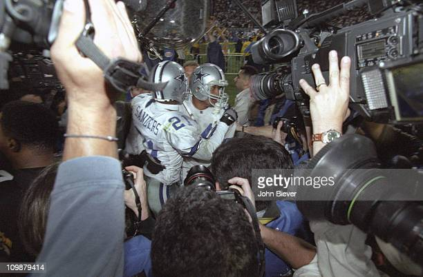 Super Bowl XXX Dallas Cowboys Deion Sanders and Larry Brown victorious surrounded by cameras after winning game vs Pittsburgh Steelers at Sun Devil...