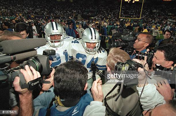 Football Super Bowl XXX Dallas Cowboys Deion Sanders and Larry Brown victorious with media after winning game vs Pittsburgh Steelers Tempe AZ...