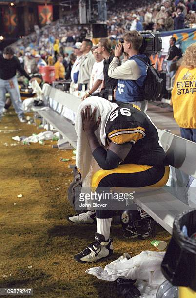 Super Bowl XXX Pittsburgh Steelers Brentson Buckner looking upset with towel over his head on bench during game vs Dallas Cowboys at Sun Devil...
