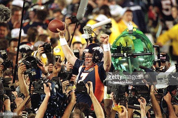 Football Super Bowl XXXII Denver Broncos QB John Elway victorious surrounded by media after winning game vs Green Bay Packers San Diego CA 1/25/1998