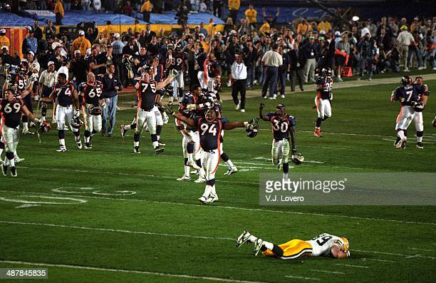 Super Bowl XXXII Denver Broncos Terrell Davis and Keith Tayloe victorious on field after winning game vs Green Bay Packers at Qualcomm Stadium Green...