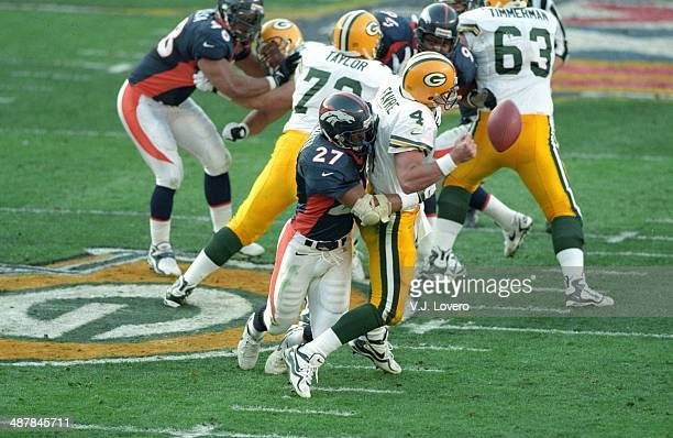 Super Bowl XXXII Green Bay Packers QB Brett Favre in action during sack vs Denver Broncos Steve Atwater at Qualcomm Stadium San Diego CA J Lovero
