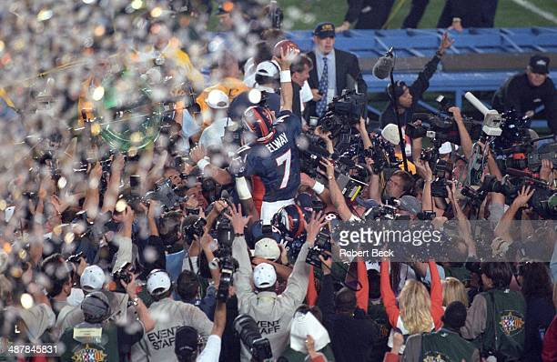 Super Bowl XXXII Rear view of Denver Broncos QB John Elway victorious after winning game vs Green Bay Packers at Qualcomm Stadium San Diego CA CREDIT...