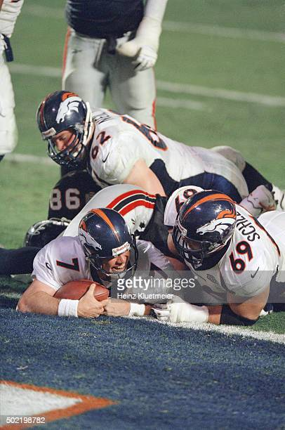 Super Bowl XXXIII Denver Broncos QB John Elway in action scoring touchdown with Mark Schlereth vs Atlanta Falcons at Pro Player Stadium Miami FL...