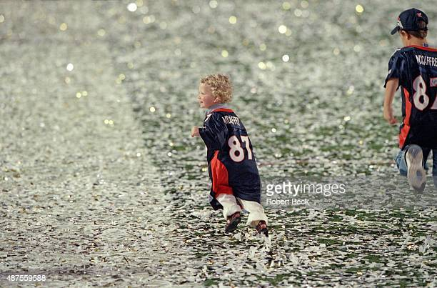Super Bowl XXXIII View of Christian McCaffrey and Mac McCaffrey sons of Denver Broncos Ed McCaffrey victorious and running on field in their father's...