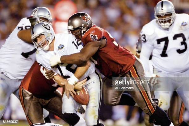 Football Super Bowl XXXVII Tampa Bay Buccaneers Warren Sapp in action forcing fumble vs Oakland Raiders QB Rich Gannon San Diego CA 1/26/2003