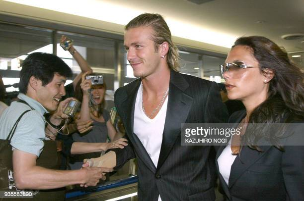 Football superstar David Beckham and his popstar wife Victoria arrive at Narita's New Tokyo International Airport 18 June 2003 Beckham said he was...
