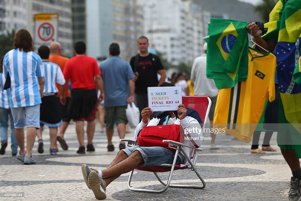 A football supporter in need of tickets alongside Copacabana Beach ahead of the 2014 FIFA World Cup Brazil Final match on July 12, 2014 in Rio de Janeiro, Brazil.