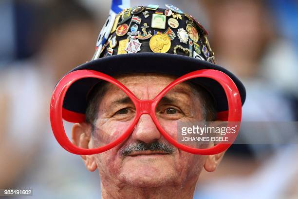 TOPSHOT A football supporter poses prior to the Russia 2018 World Cup Group E football match between Switzerland and Costa Rica at the Nizhny...