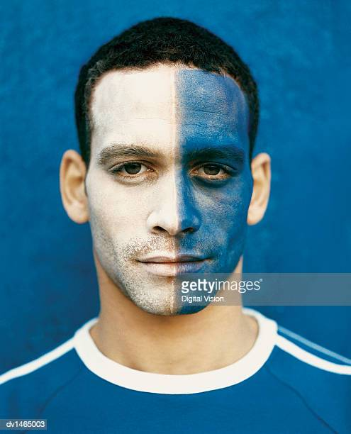 football supporter with a painted face - face paint stock pictures, royalty-free photos & images