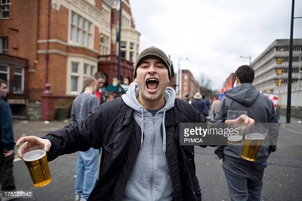 Football supporter with three pints of beer in his hands Arsenal V Chelsea Cup Final Cardiff 2006
