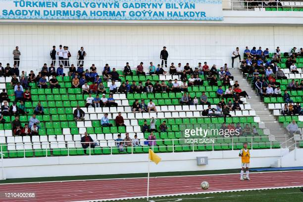 Football supporters attend the Turkmenistan national football championship match between Altyn Asyr and Kopetdag on April 19 amid the COVID-19...