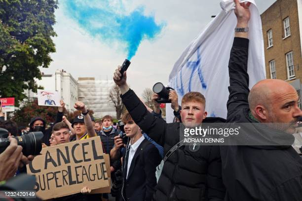 Football supporters demonstrate against the proposed European Super League outside of Stamford Bridge football stadium in London on April 20 ahead of...