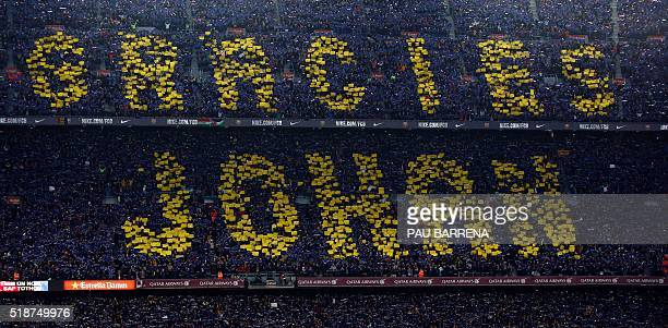 Football supporters holdup coloured rectangular posters to form a giant mosaic reading 'Thankyou Johan' in tribute to late Dutch football player...