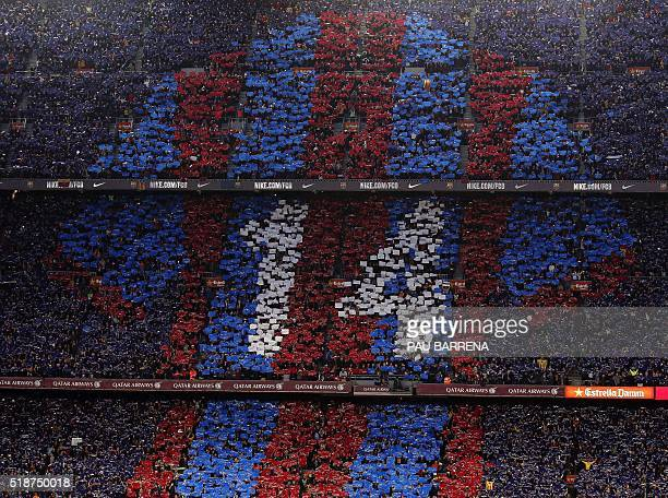 Football supporters holdup coloured rectangular posters to form a giant mosaic of the number 14 jersey in tribute to late Dutch football player Johan...