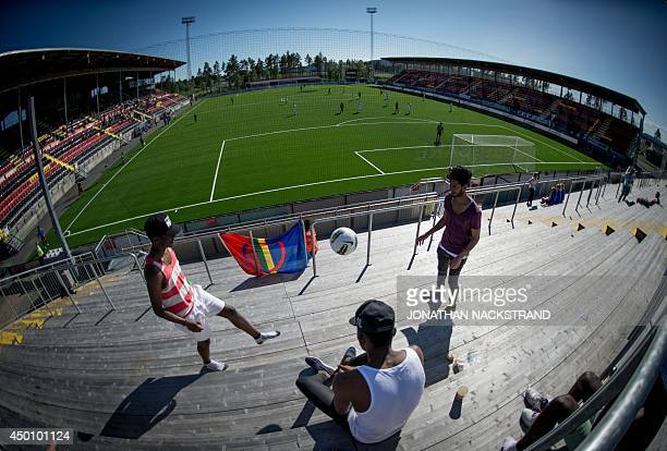 Football supporters play with a ball during the CONIFA World Football Cup 2014 match between Abkhazia and Sapmi on June 2 2014 in Oestersund Sweden...