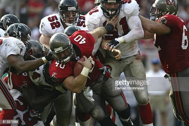 Football: Tampa Bay Buccaneers Mike Alstott in action during pileup tackle vs Atlanta Falcons, Tampa, FL 12/8/2002