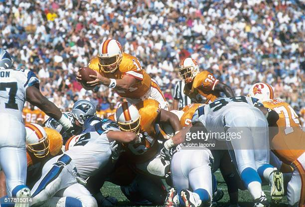 Tampa Bay Buccaneers QB Casey Weldon in action going over the top scoring touchdown vs Carolina Panthers at Memorial Stadium Clemson SC CREDIT John...