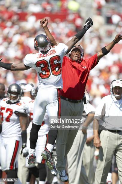 Tampa Bay Buccaneers Tanard Jackson victorious chest bump with coach Johnny Cox during game vs Carolina Panthers Tampa FL CREDIT Damian Strohmeyer