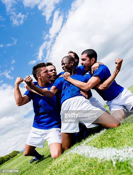 Football team celebrating a goal