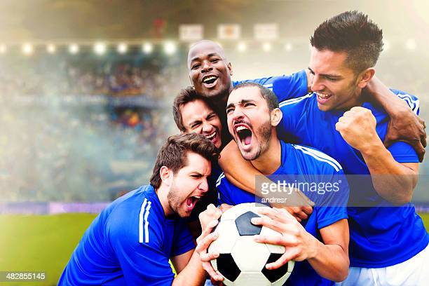 football team celebrating a goal - scoring a goal stock pictures, royalty-free photos & images
