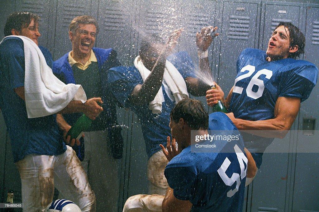 Football team celebrating : Stock Photo