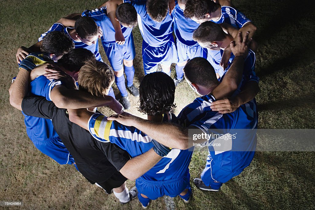 Football team in a huddle : Stock Photo