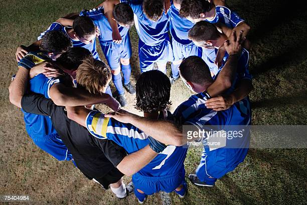 football team in a huddle - sports team stock pictures, royalty-free photos & images