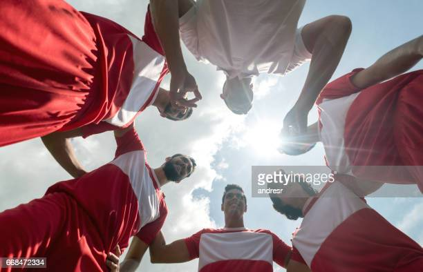 football team listening to the coach's tactics - pep talk stock pictures, royalty-free photos & images