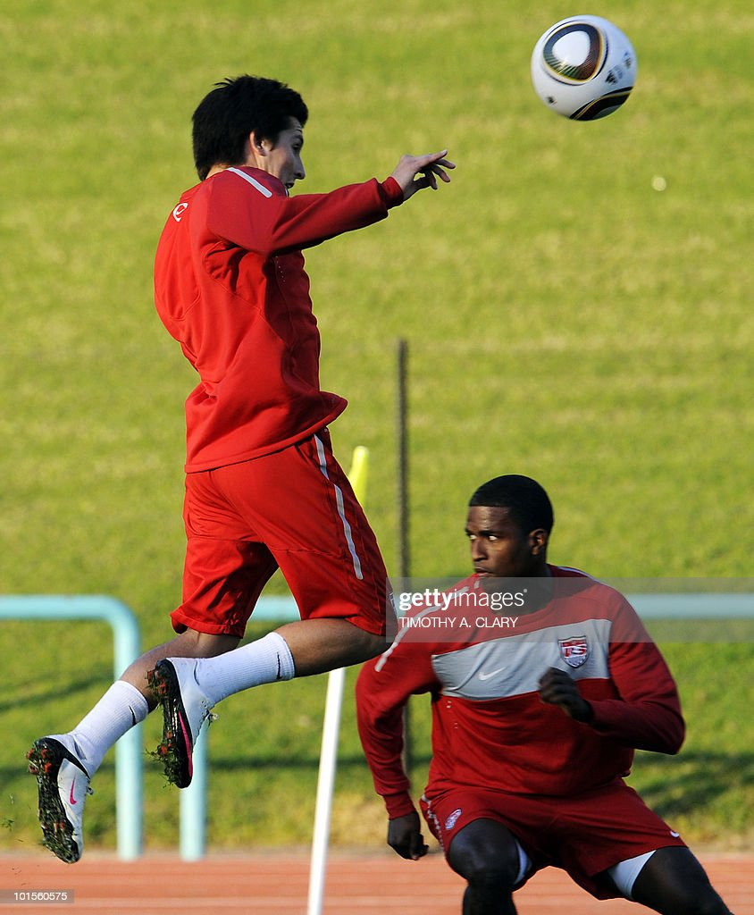US football team player Jose Torres (L) heads the ball as he takes part in a training session with forward Edson Buddle at Pilditch Stadium on June 2, 2010 in preparation for the 2010 FIFA World Cup held in South Africa.